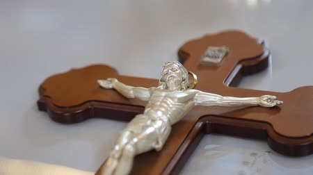 crucified : crucifix, jesus on the cross in church with ray of light from stained glass Stock Footage