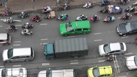 Aerial top view of chaotic traffic by motorbikes and scooter at night in Saigon Ho Chi Minh City Vietnam