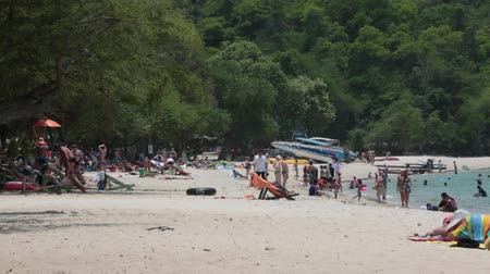 Pattaya,Thailand- MARCH 20,2018: Sai Kaew Beach -Military Beach.People sunbathe and swim.Some vacationers stroll along the shore