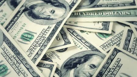 bringing home the bacon : Video of many USA 100 dollar bills rotating. Real money.  Stock Footage