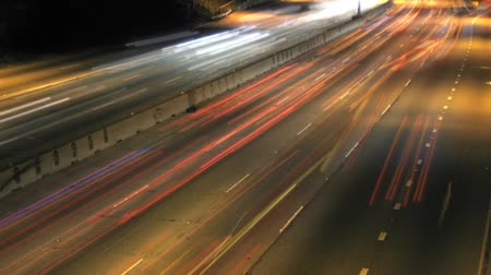 streaking : Traffic streaking by on the freeway. Shot on DSLR.- Stock Footage