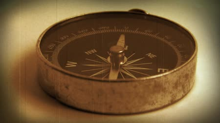 запад : Macro close-up shot of antique compass on paper. HD 1080.-