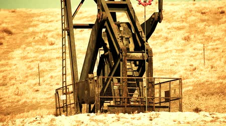natura : Close-up of mechanics - Oil pump at an oil field in the California desert. Shot on Canon HD 1080. Seamless looping clip. Circa 2009.-
