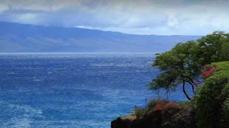 vacation destination : View of Lanai island from Black Rock on Maui in Hawaii during the day.-
