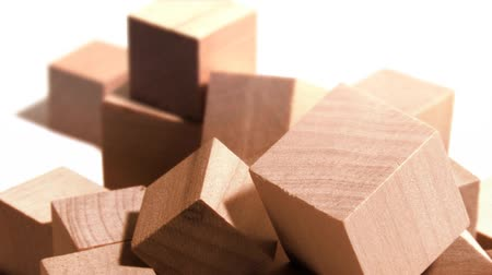 лесоматериалы : Abstract group of wooden blocks rotating on white studio set. Shot on 3CCD HD 1080p.- Стоковые видеозаписи