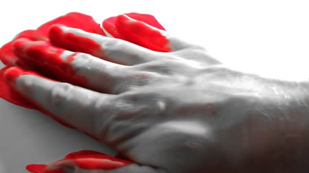 lawbreaker : Person placing bloody hand on white surface. Shot on HDV 1080.-