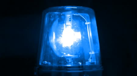 Isolated blue warning light with black background. Shot on HD 1080p. Seamless looping video.-