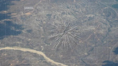 crosshair : Aerial view camera track of bombmissile hitting target on the ground and exploding. This is a simulated digital 3D animation. There is also a night vision infrared version in my portfolio. No animals were harmed.-
