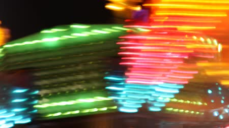 karnaval : Abstract fast paced action of carnival ride at night.- Stok Video