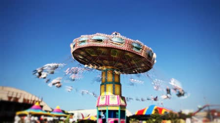 karneval : Fast time-lapse of the carousel swing ride at the carnival midway. Selective spot focus in center of image.-
