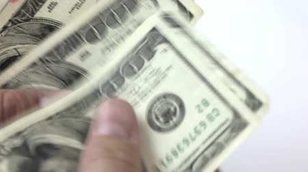 bringing home the bacon : Close-up of person counting U.S. $100 dollar bills on white background. HD 1080.