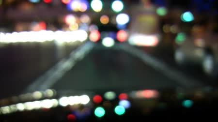 droga : Camera optical defocus driver POV driving in the city at night.