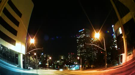 bulanık : Los Angeles Skyline at night with traffic streaking by, city buildings and lights.-