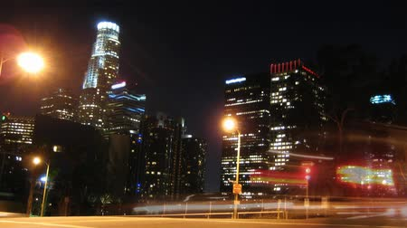 ночная жизнь : Los Angeles Skyline at Night with traffic streaking by. HD 1080 Loop.-