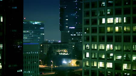 night scene : Riding the glass elevator in downtown Los Angeles at night. There is a little bump here and there caused by the elevator. Shot on HD 1080p.- Stock Footage