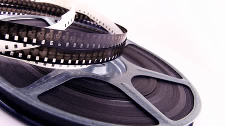 filmes : Old 8mm films and reels rotating on white background. Shot on HD 1080p.-