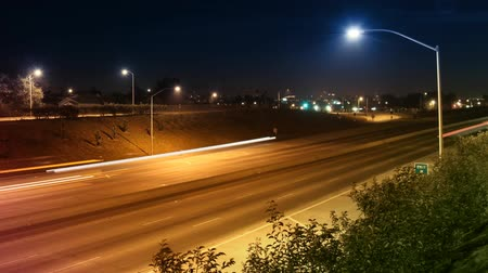 asfalt : 300+ frame time-lapse of traffic driving past on freeway at night.-