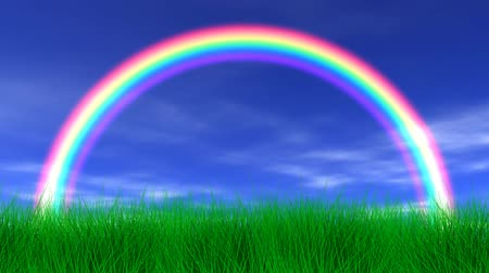 trawnik : Rainbow, blue sky, light clouds, slight breeze and lush green grass. Seamless looping video animation.-