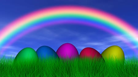 wielkanoc tło : Easter Eggs, rainbow, blue sky, light clouds, slight breeze and lush green grass. Seamless looping video animation.-