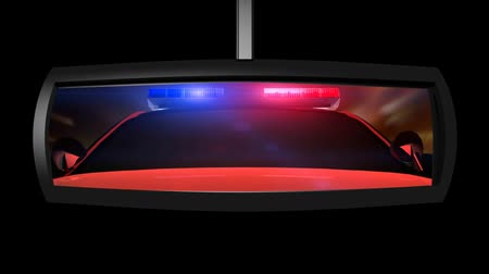3D animation with live action footage composite of police car in the rearview mirror with lights flashing. Seamless looping video animation.