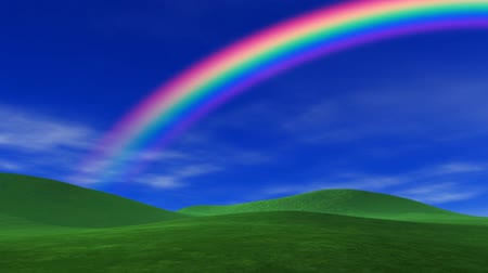 owady : Blue sky, rainbow, light clouds, slight breeze and lush green grass. HD seamless looping video animation.-