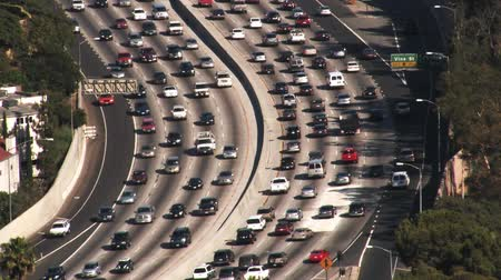 Daytime high POV shot looking down on traffic on the 101 Ventura Fwy in Hollywood, CA. Circa 2007. Shot on 3CCD HD 1080P.-
