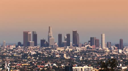 office life : Pull back zoom of Los Angeles downtown skyline at sunset. Hazy sky. Shot on 3CCD HD 1080. Circa 2007.- Stock Footage