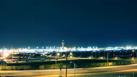 ночная жизнь : Wide angle view of Los Angeles International Airport (LAX). Night time-lapse. Super high resolution shot on DSLR. See my portfolio for more in this series. No logos or trademarks. Shot from public space.- Стоковые видеозаписи
