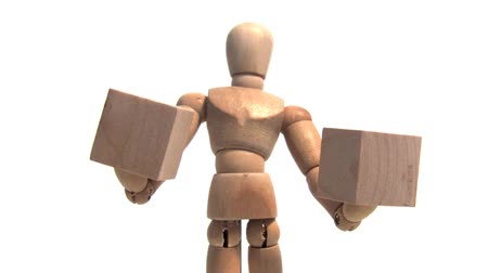 transportar : Wooden mannequin holding two wooden blocks. Shot on HD 1080. Seamless looping clip.-