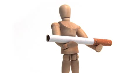 self harm : Wooden mannequin holding a cigarette. Shot on HD 1080. Seamless looping clip.-