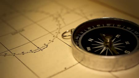 batı : Macro close-up shot of antique compass on paper. HD 1080.-