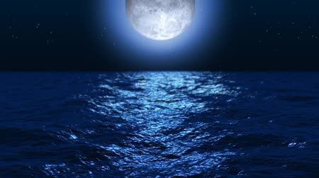 modrá obloha : Moon setting over the ocean at night. Stars in the sky. Seamless looping video animation.-