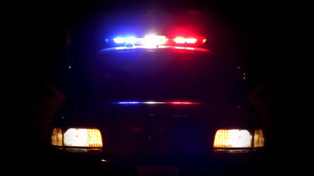 autoridade : Wide shot of police cruiser with lights flashing. Shot on HD 1080 nice and clean with intense colors and blacks. Many thanks to local officers for their cooperation in getting this video footage.-