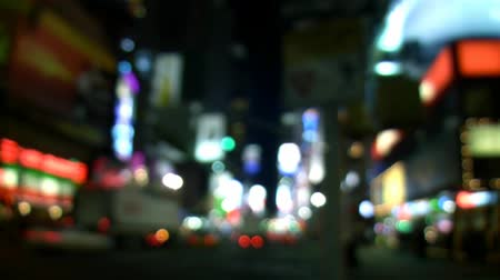 no traffic : Camera defocused (not done in post) shot of cars going by on busy New York City street facing towards Times Square. Shot on HD 1080p. 30FPS. Contains no logos or trademarks.- Stock Footage