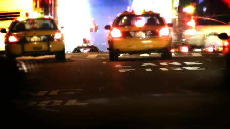 night scene : Traffic going by on busy New York City street. Contains no logos or trademarks. Shot on HD 1080p. 30FPS.-