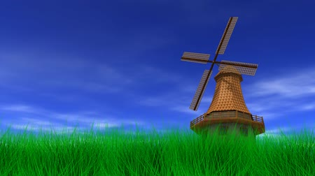 moinho de vento : Windmill in a grassy field on a beautiful, breezy day. 3D animation, seamless looping video.-