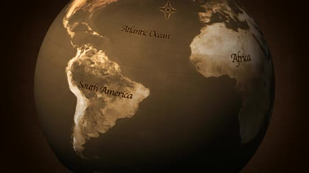 cartografia : Composite rendered animation of the Earth, old film look. Custom old look map and text created in Photoshop. Animated in AE. Seamless looping video animation.-