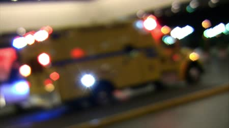 ambulância : Optical defocus shot of emergency fire EMS truck at scene with lights flashing.-