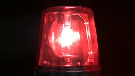karetka : Isolated red warning light with black background. Shot on HD 1080p. Seamless looping video.- Wideo
