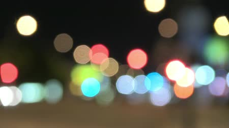 hz : Camera optical defocus of city lights and traffic at night.