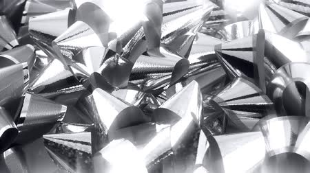 ezüst : Close-up depth of focus shot of shiny BirthdayChristmas present bows. Shot on 1080p.-