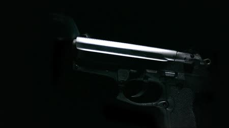 стрельба : Hand gun with smoking barrel. Seamless HD 1080 Loop. Shot on HDV 1080.- Стоковые видеозаписи