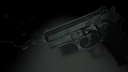 стрельба : Photographed hand gun with smoking barrel. Seamless HD 1080 Loop. v.3-
