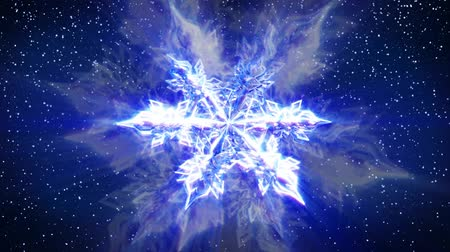 mrożonki : Shiny, sparkling, glowing, colorful snowflake. Rotates and turns on blue snowy backdrop. HD 1080 Seamless Loop.- Wideo
