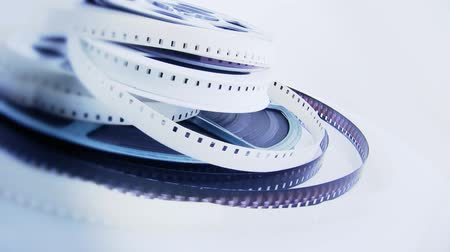 antiquado : Old 8mm films and reels rotating on white background. Shot on HD 1080p.-