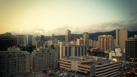 d day : View of the Waikiki, Hawaii downtown skyline at sunset. Shot on D-SLR 1080P.-