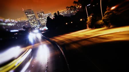 streaking : Very clean D-SLR time-lapse video. No Noise. West Los Angeles Skyline at Night with traffic streaking by on the 405 freeway. HD 1080.-