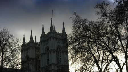 londyn : Silhouette locked off shot of Westminster Abbey church in Westminster, London, England. Subtle clouds in sky. Shot on 1080p HDV.- Wideo