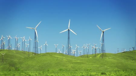 anahtar kelimeler : Spinning wind turbines on green hills and clear blue sky. Shot on HD 1080p 4:2:2. Stok Video