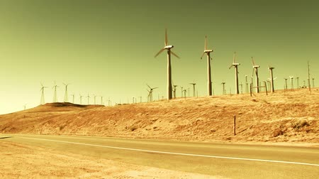 turbine : Spinning wind turbines on hills, hot summer day. Shot on HD 1080p 4:2:2.